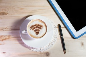Wifi logo made of cinnamon on cappuccino
